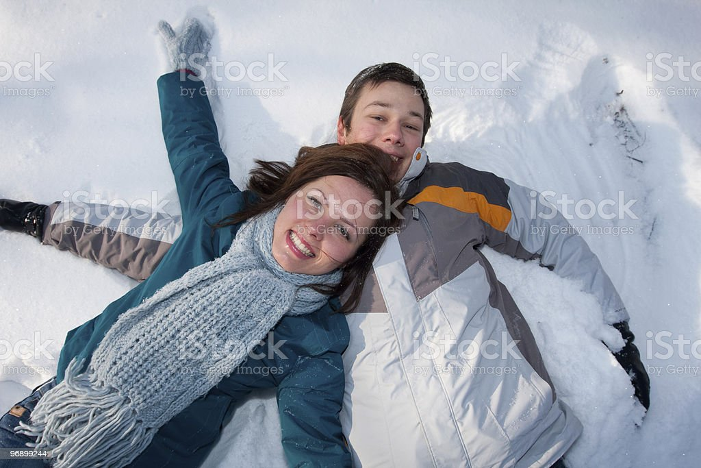 Couple in winter park royalty-free stock photo