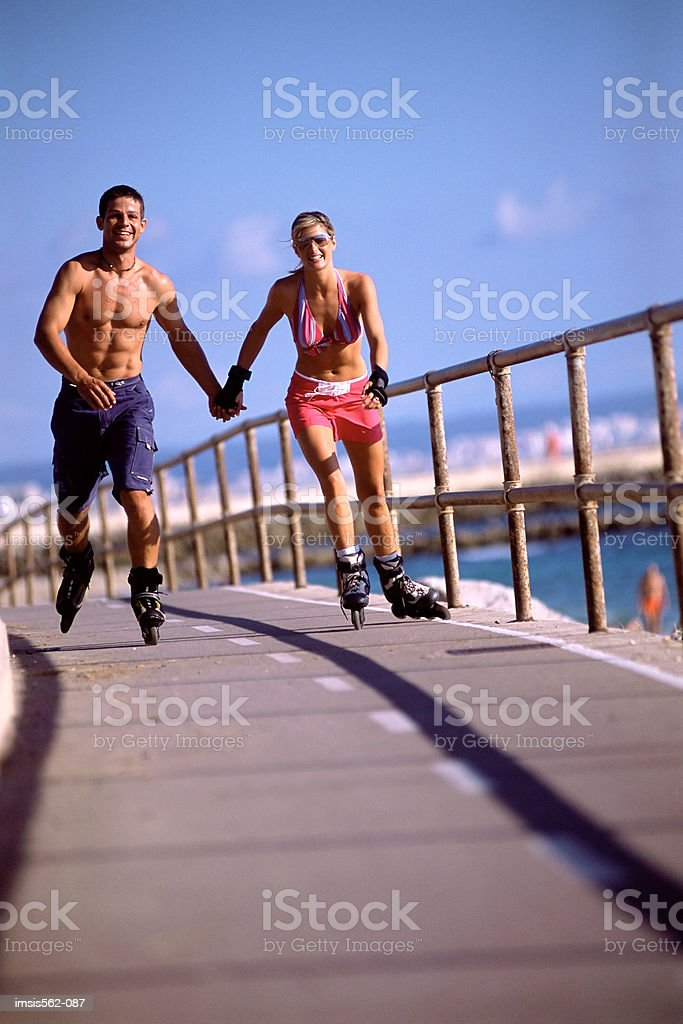 Couple in-line skating royalty-free stock photo