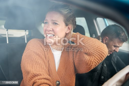 istock Couple Involved In Car Crash With Female Driver Suffering With Whiplash Injury 1156650688