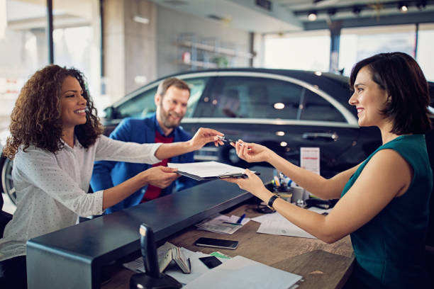Couple is buying new car and signing the contract Couple is buying new car and signing the contract dealing cards stock pictures, royalty-free photos & images