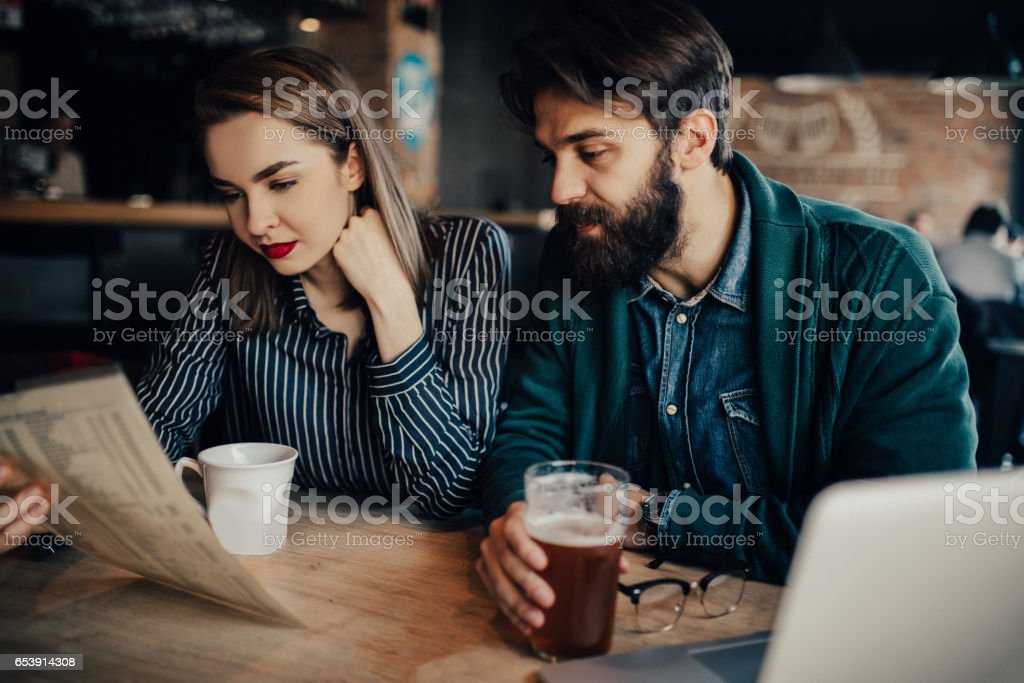 Couple is choosing food from the menu stock photo
