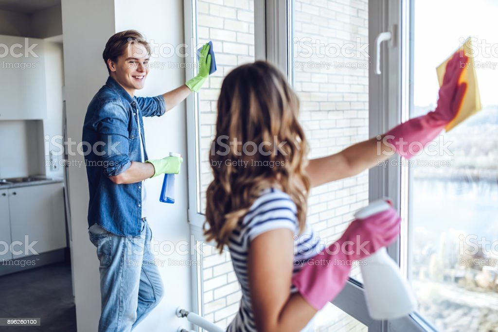 Couple is doing cleaning at home. stock photo