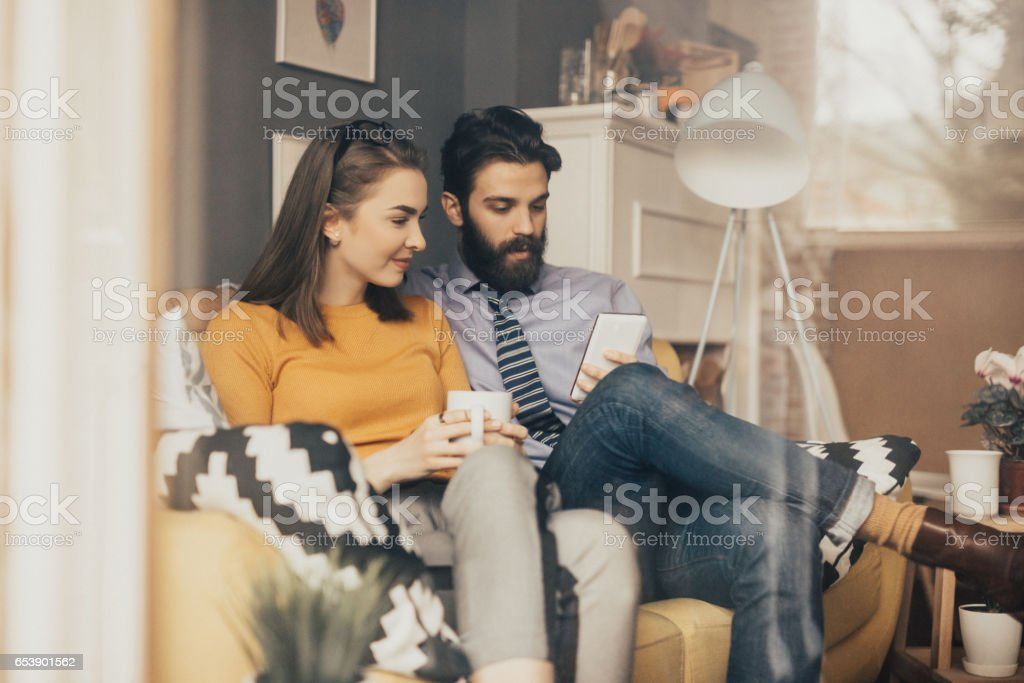 Couple is having a morning coffee together before leaving for work stock photo