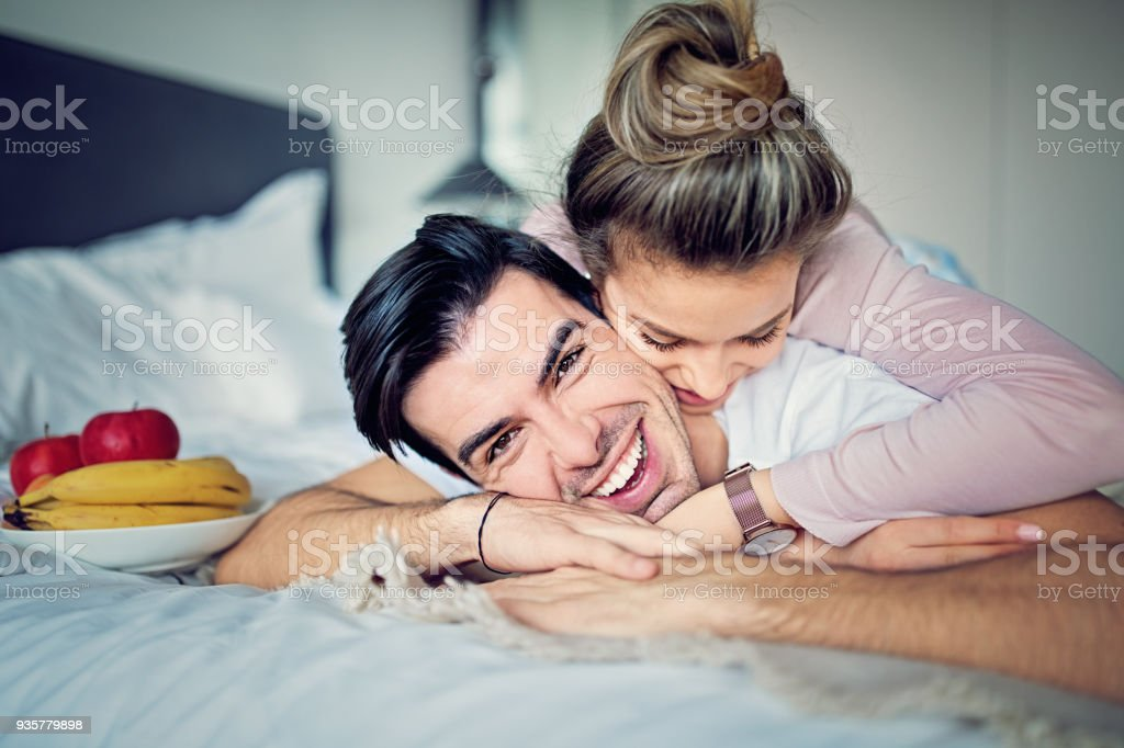 Couple Is Hugging On The Bed In Morning Royalty Free Stock Photo