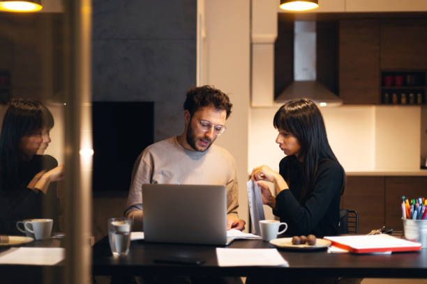Couple is paying bills from home stock photo