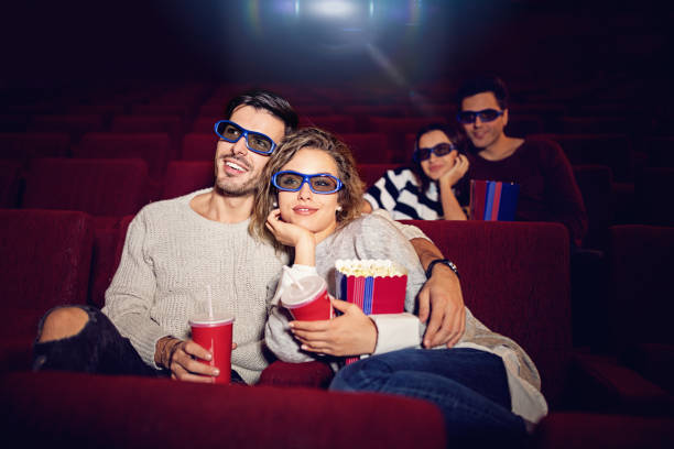 Couple is watching 3D movie in the cinema theater stock photo