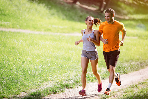 Couple jogging and running outdoors in nature