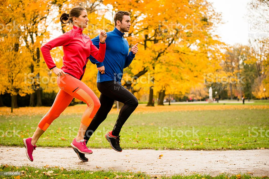Couple jogging in autumn nature - Royalty-free 2015 Stock Photo