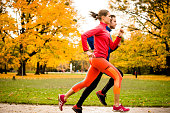 Couple jogging in autumn nature