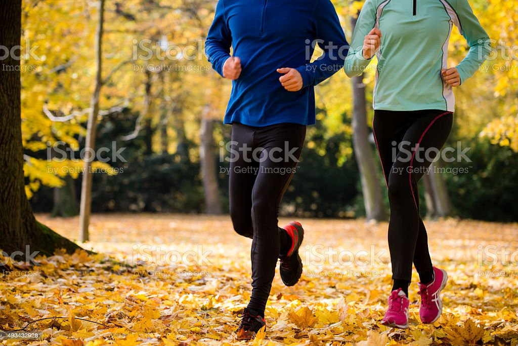 Couple jogging in nature stock photo