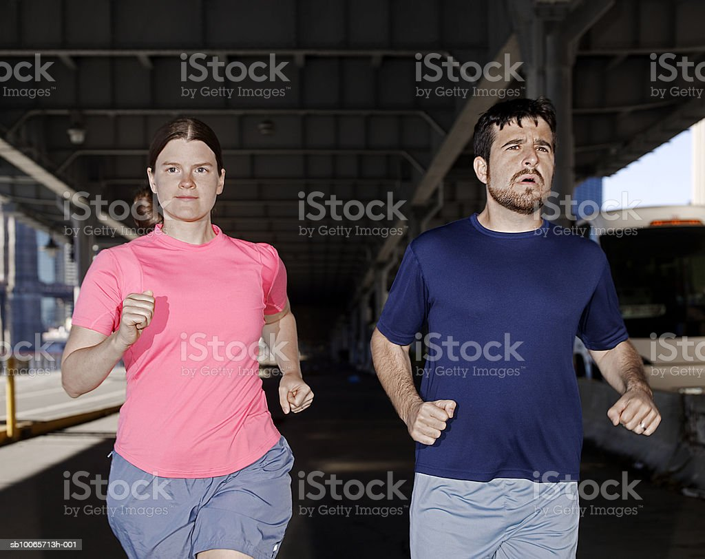 Couple jogging near East river 免版稅 stock photo