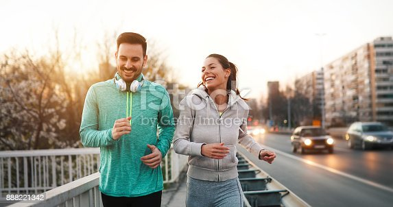 istock Couple jogging outdoors 888221342
