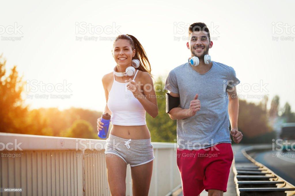 Couple jogging outdoors zbiór zdjęć royalty-free