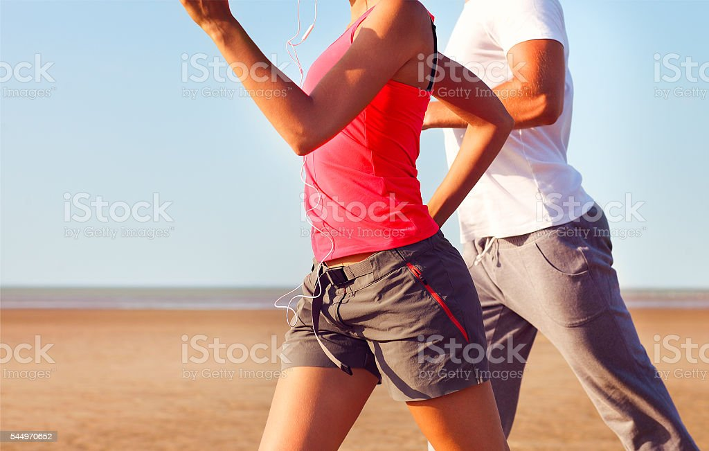 Couple jogging outside. Close up stock photo