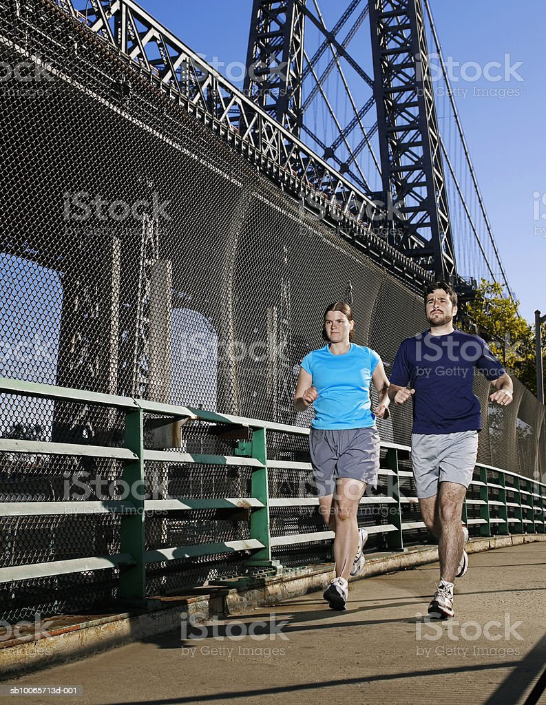 Couple jogging royalty free stockfoto