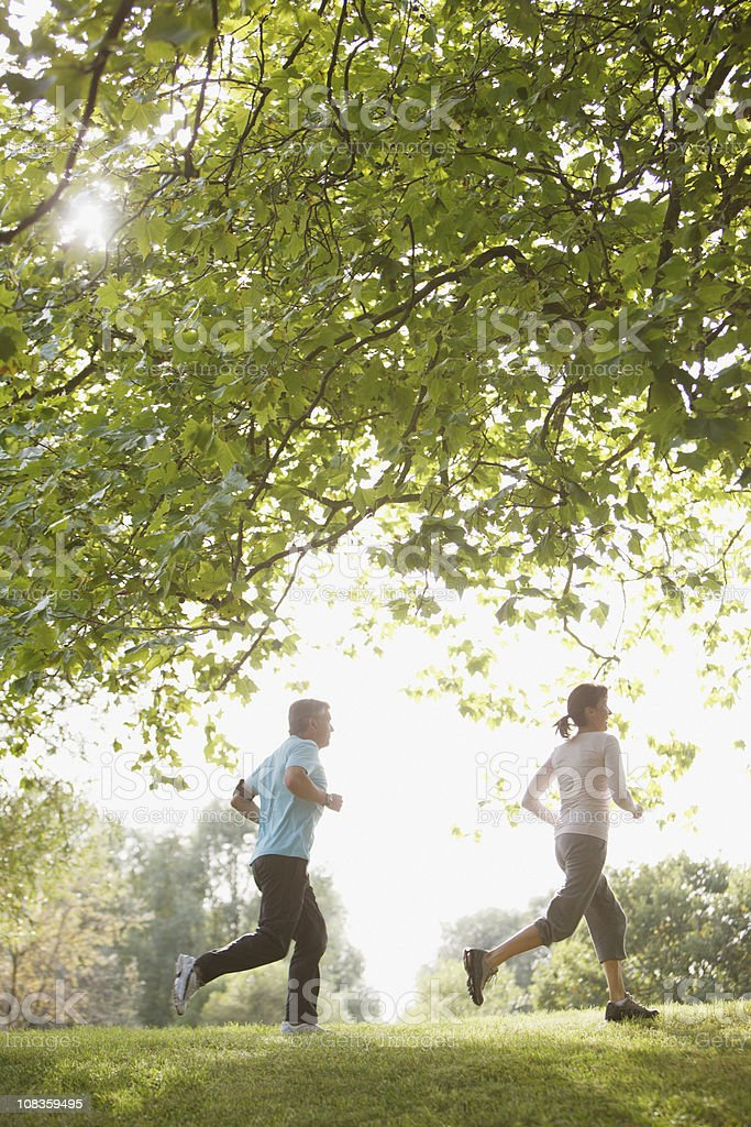 Couple jogging together outdoors royalty-free stock photo