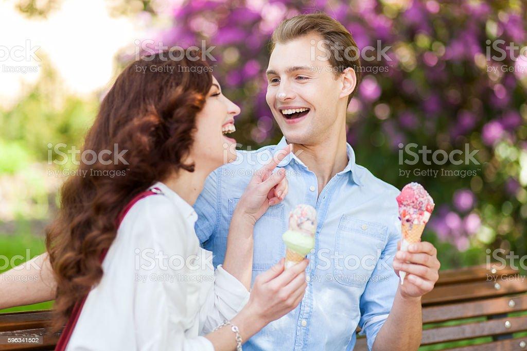 Couple joking and having fun while eating an ice cream Lizenzfreies stock-foto