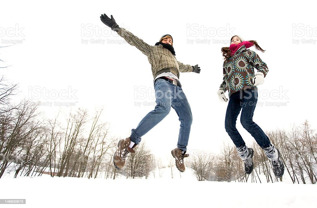 Couple jumping in snow royalty-free stock photo