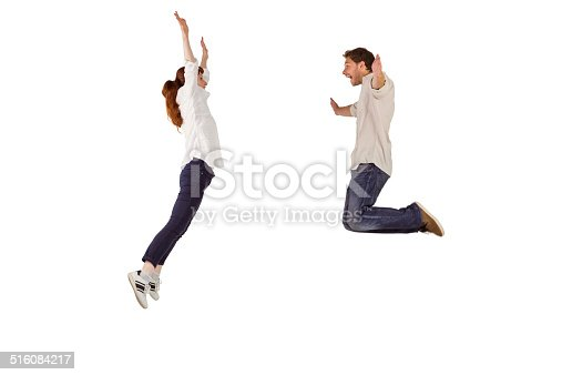 istock Couple jumping in the air 516084217