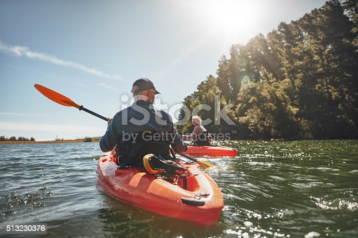 istock Couple kayaking in the lake on a sunny day 513230376
