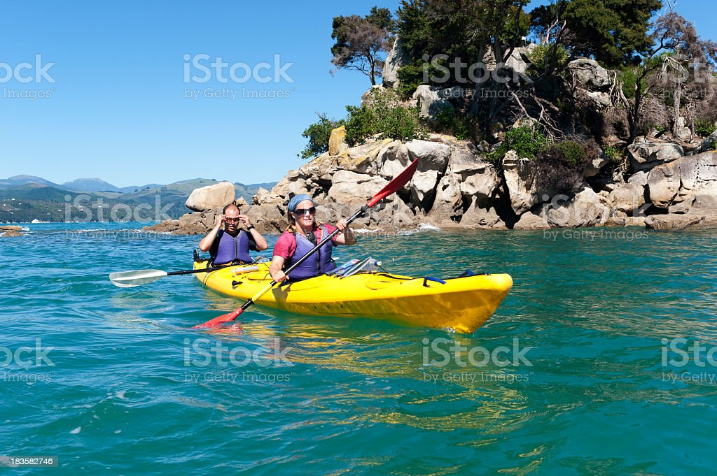A couple kayaking on the Abel Tasman stock photo