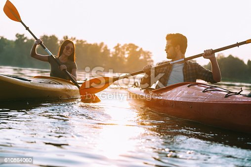 istock Couple kayaking together. 610864060