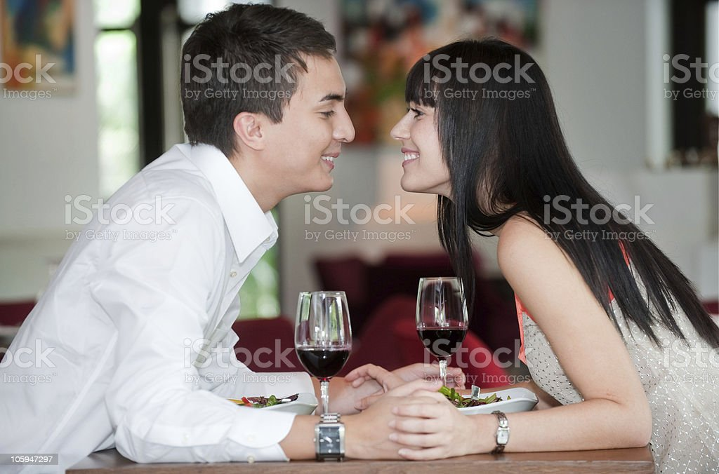 Couple Kiss Over Meal royalty-free stock photo