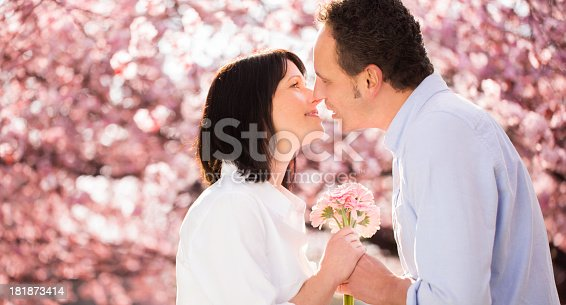 510491454istockphoto Couple kissing after mature man proposed 181873414