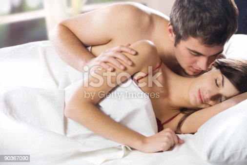 888274920 istock photo Couple kissing and hugging on the bed in bedroom 90367090