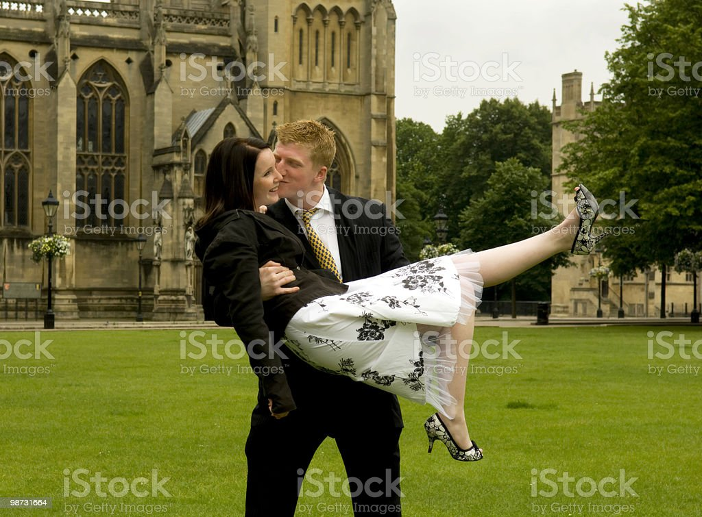 Couple kissing at the church royalty-free stock photo