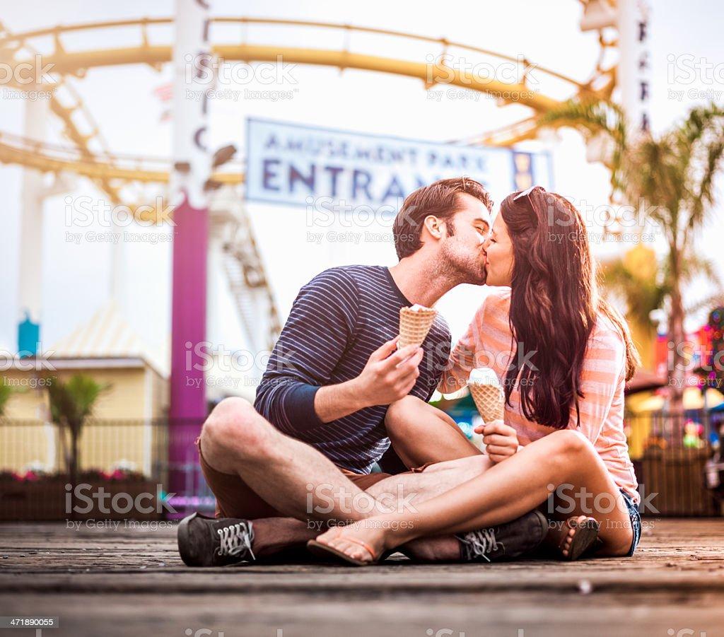 Couple kissing in amusement park, LA stock photo