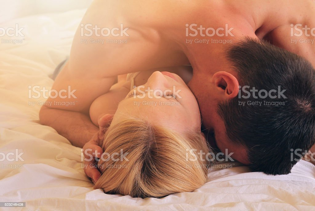Couple kissing in bed. Love, Sex, Foreplay, Relationship, Tenderness concept stock photo