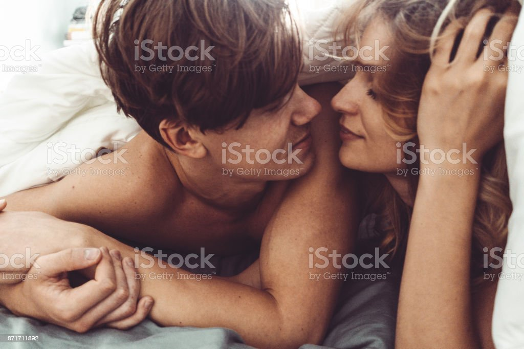 couple kissing in the bedroom stock photo