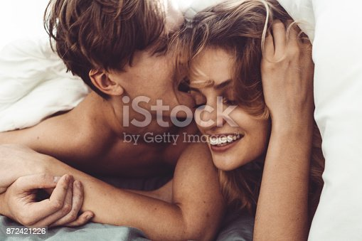 505826794 istock photo couple kissing in the bedroom 872421226