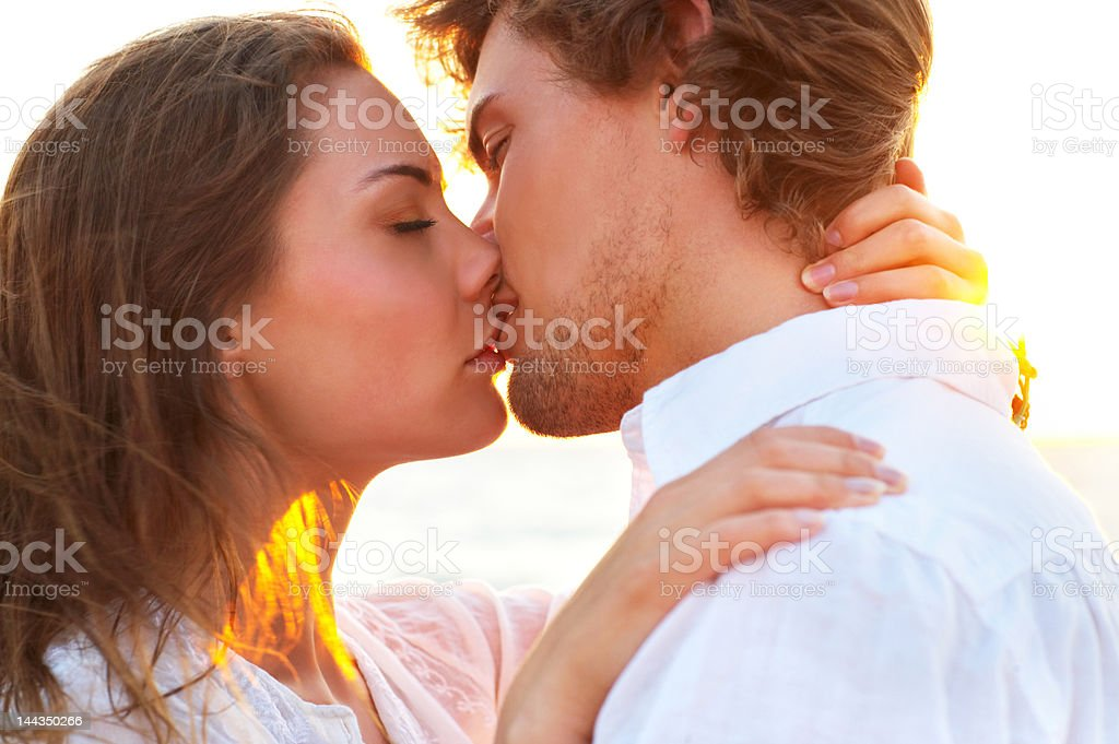 Couple kissing on the beach royalty-free stock photo