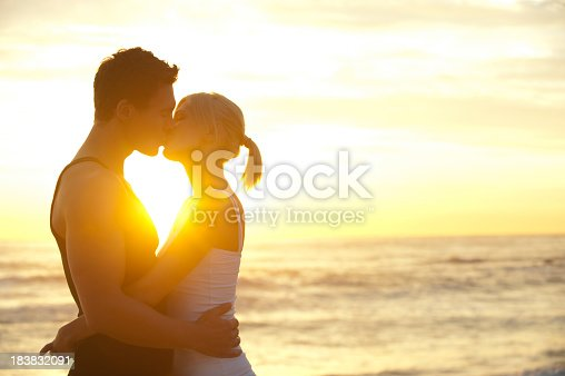Couple Kissing On The Beach Stock Photo  More Pictures Of Adult  Istock-2721