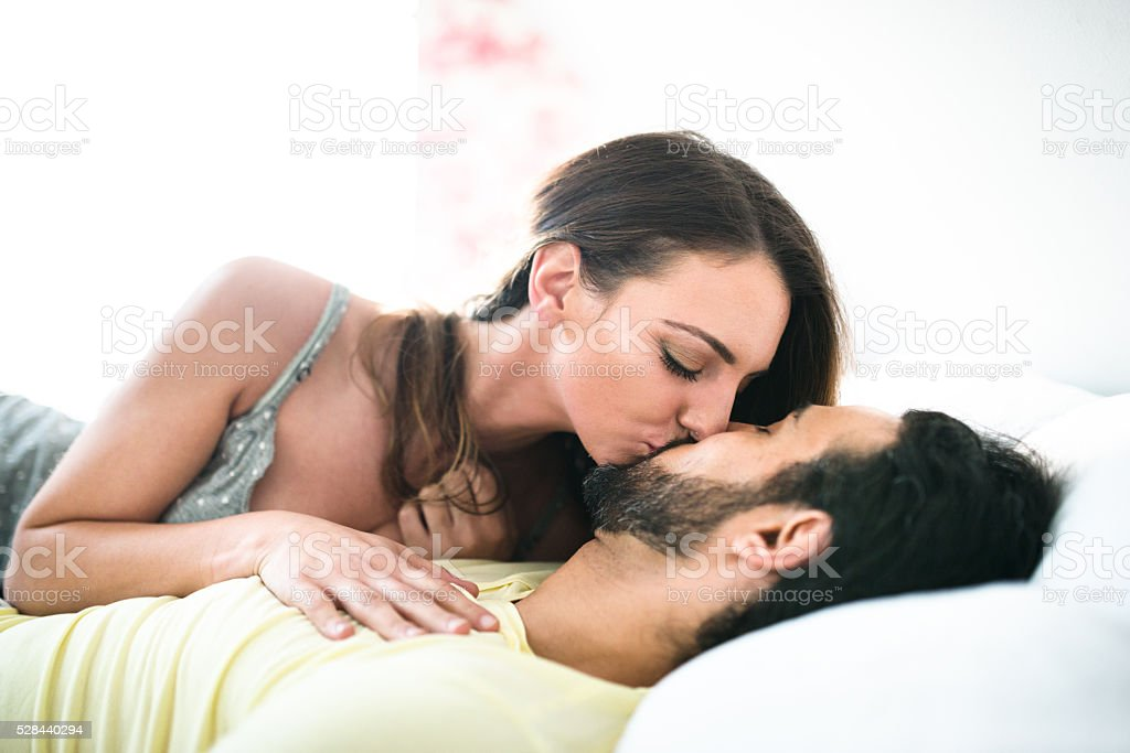 Couple Kissing On The Bed On Early Morning Stock Photo -1177