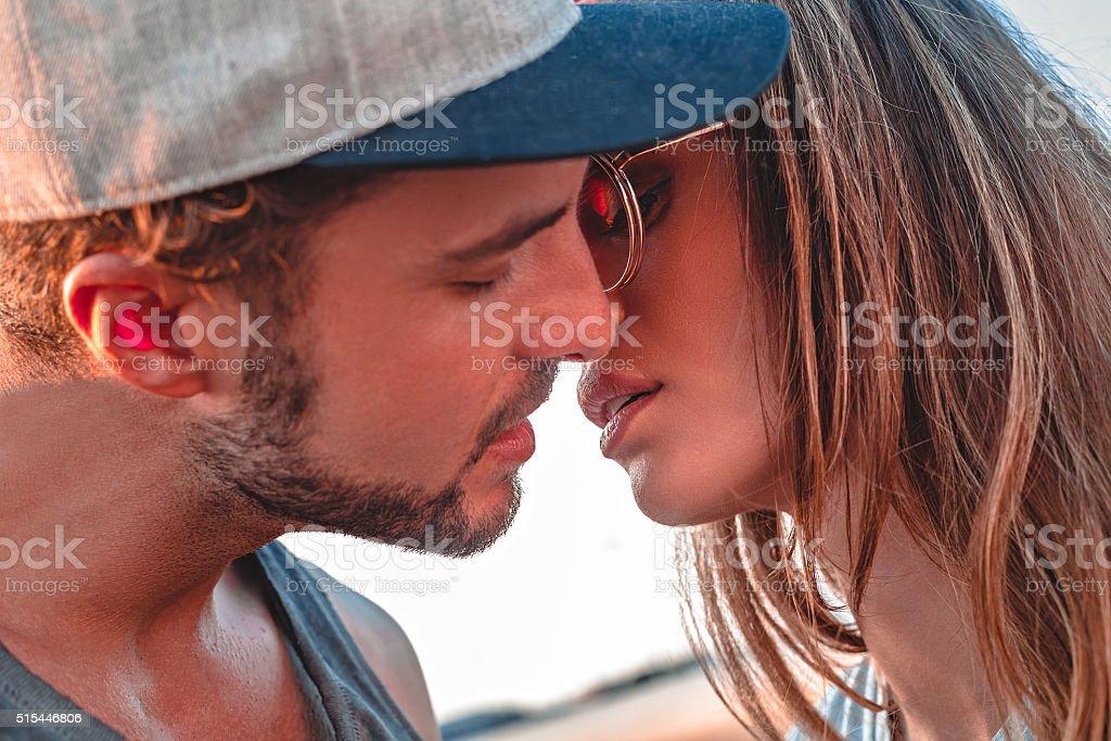 Couple kissing outside stock photo