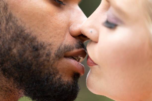 A couple kissing stock photo