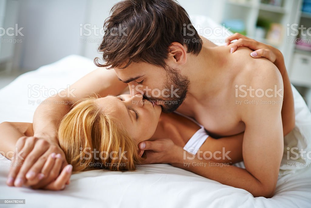 Couple kissing stock photo