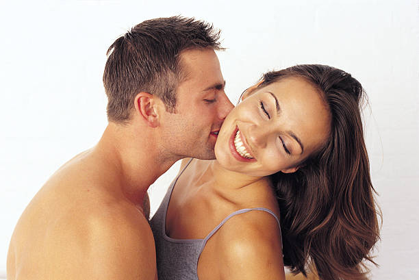 couple kissing - kissing on neck stock photos and pictures