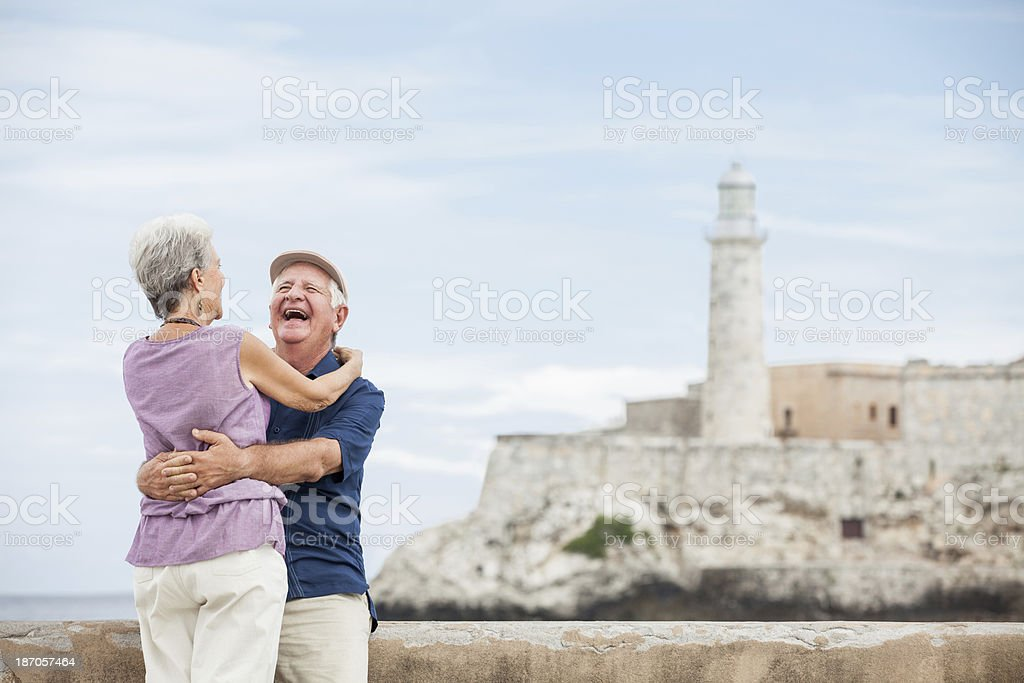 Couple laughing and enjoying their vacations royalty-free stock photo