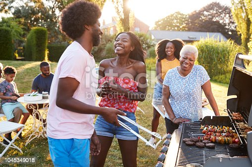 istock Couple laughing at a multi generation family barbecue 1045349018