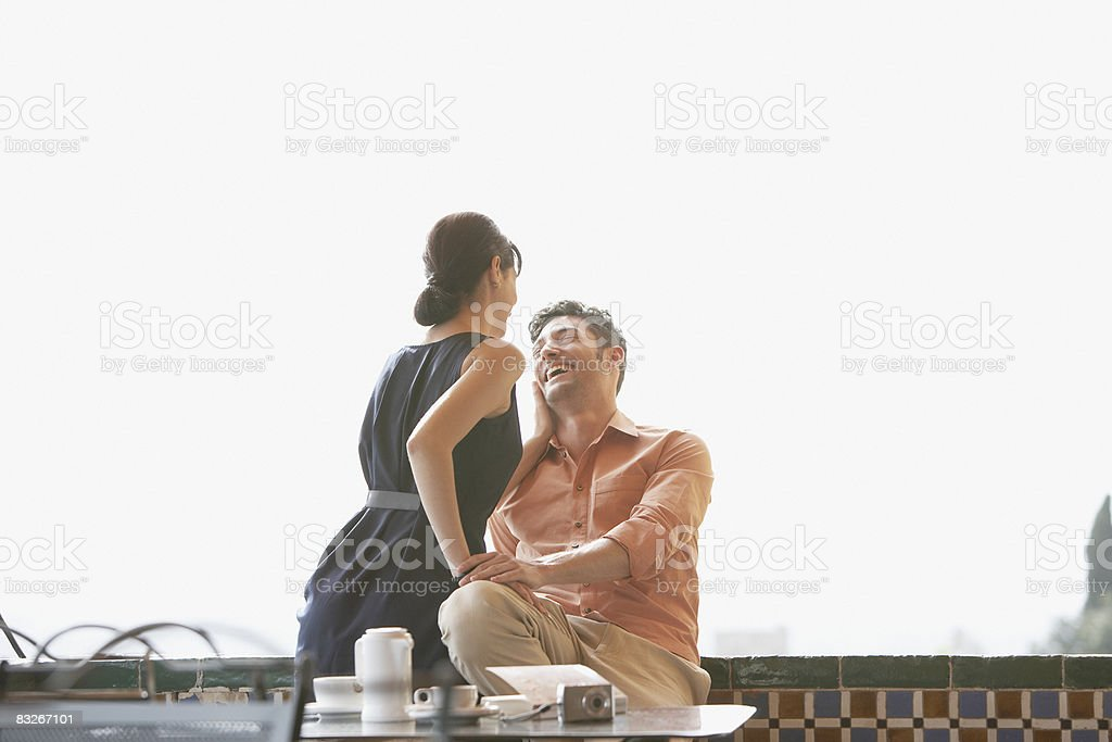 Couple laughing in cafe royalty-free stock photo