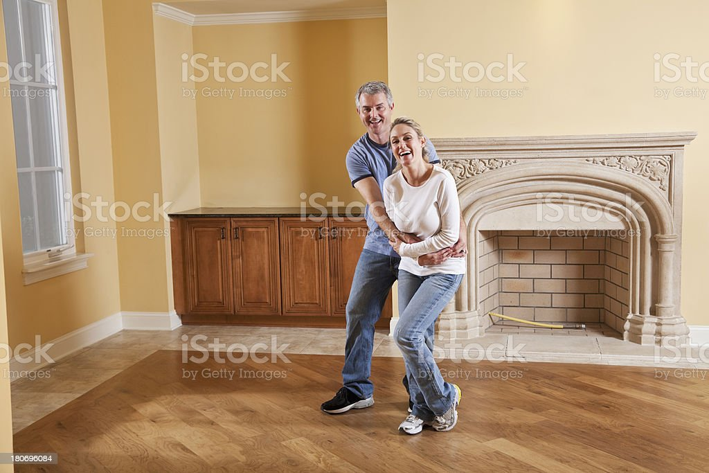 Couple laughing in new home stock photo