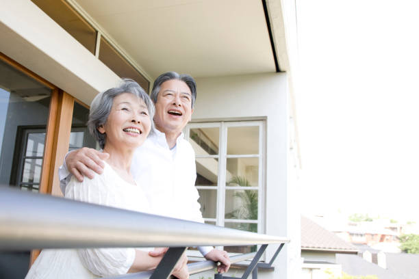 Couple laughing on the porch stock photo