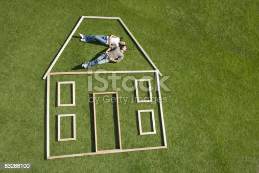 istock Couple laying inside house outline 83266100