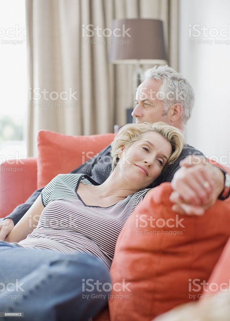 Couple laying on sofa royalty-free stock photo