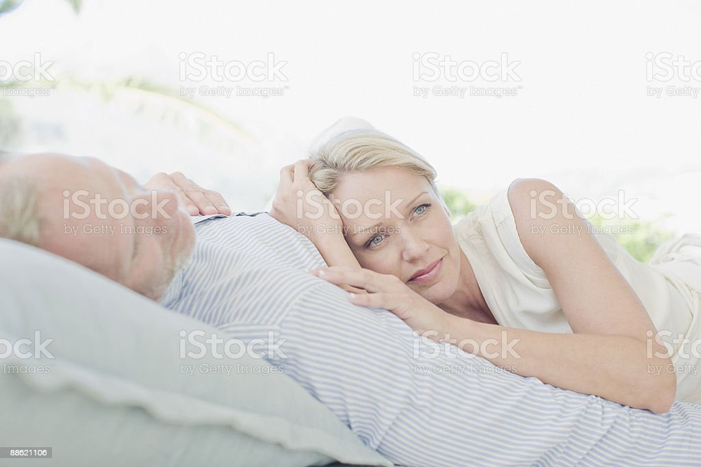Couple laying on sofa together royalty-free stock photo