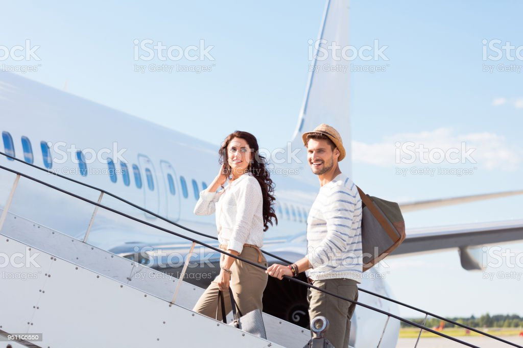 Couple leaving for a vacation stock photo